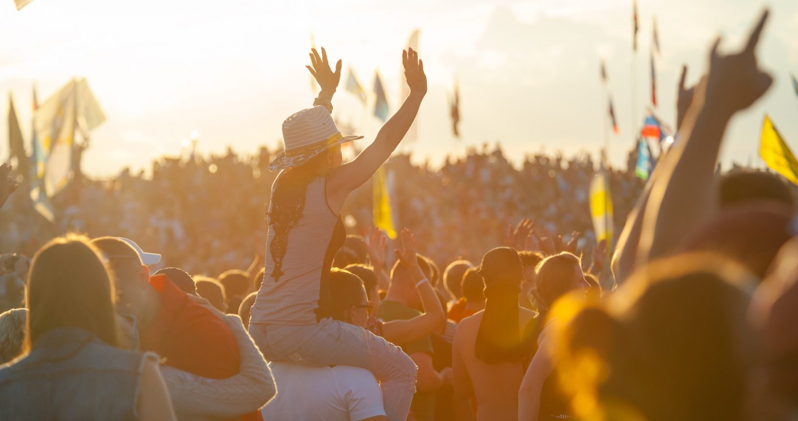 """BIG ZAVIDOVO, RUSSIA - JULY 5: People cheering at open-air rock festival """"Nashestvie"""" on July 5, 2014 in Big Zavidovo, Russia. """"Nashestvie"""" is the biggest rock festival in Russia, more 200000 visitors"""